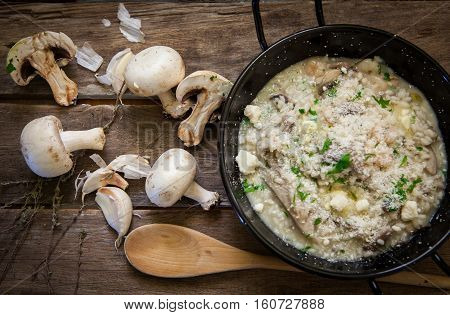 Italian risotto with mushrooms fresh herbs and parmesan cheese