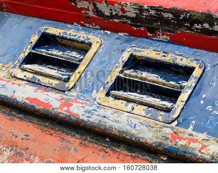 Distressed paintwork and feature detail from a decommissioned lifeboat at Barmouth Gwynedd Wales.