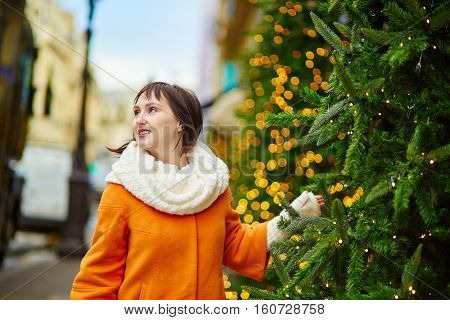 Cheerful Young Woman In Paris At Christmas