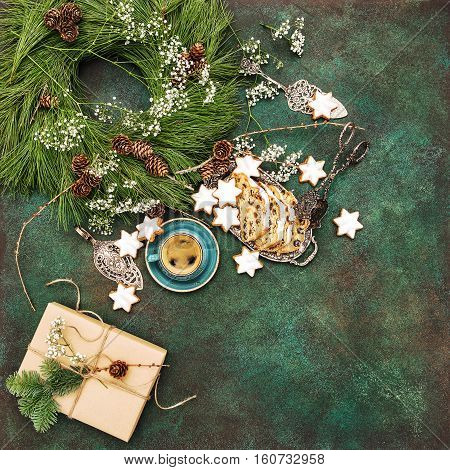 Christmas cake Stollen star cookies coffee and decoration. Food background. Vibrant colors. Vintage style toned picture