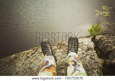 Feet In Camouflage Pants, Rocky Coast