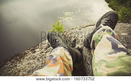 Male Feet In Camouflage Pants