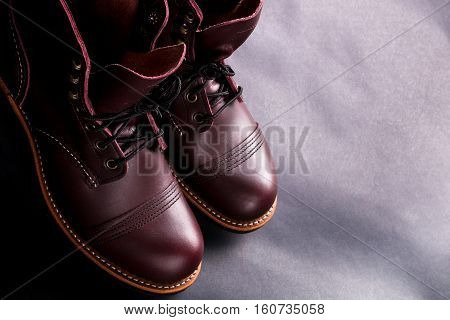High Boots. Fashionable Mens Leather Brown Shoes On Light Black Background.  Top View. Copy Space.