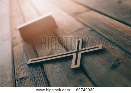 Cross And Bible On Old Wooden Background.