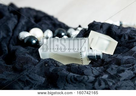 Women Outfit. Evening Accessory For Party. Necklace And Perfume On Black Lace Dress Background.