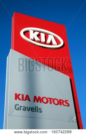 Kidwelly, Wales, UK, November 20, 2016 : A  Kia motor company sign at their car showroom on the towns outskirts