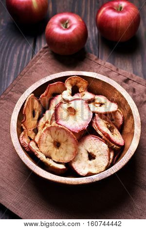 Dehydrated apples chips in wooden bowl healthy snack