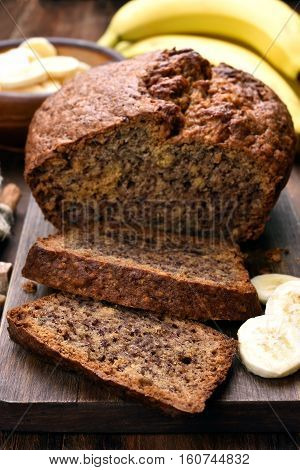 Sliced sweet banana bread on wooden board