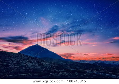 Silhouette Of Volcano Del Teide Against A Sunset Sky. Pico Del Teide Mountain In El Teide National P