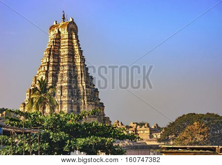 Virupaksha Temple located in the ruins of ancient city Vijayanagar at Hampi India. View from Hampi. It is part of the Group of Monuments at Hampi designated a UNESCO World Heritage Site.