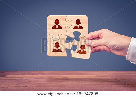 Assemble a team concept. Business team, human resources, cooperation, connection and unity concepts. Good team fit together like puzzle pieces.