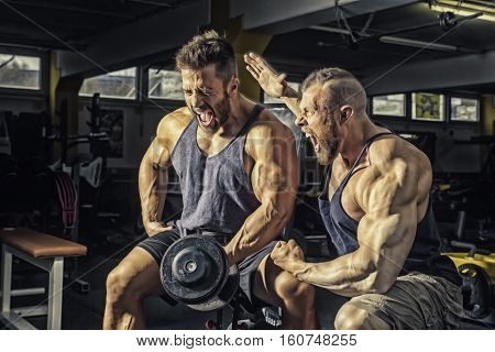 An image of two men at the gym
