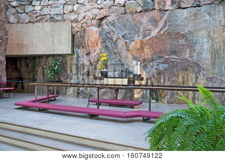 Helsinki, Finland - April 10, 2010:  Altar in the interior of Temppeliaukio Church (Church of the Rock) on Lutherinkatu. Was built directly into solid rock and opened in 1969