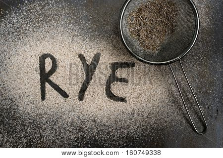 Sifted rye flour on oven tray with word on it