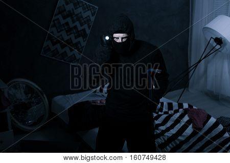Robber Holding Flashlight And Crowbar