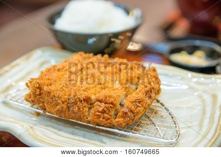 Fried Pork Cutlet serve with rice in dish at Japanese restuarant