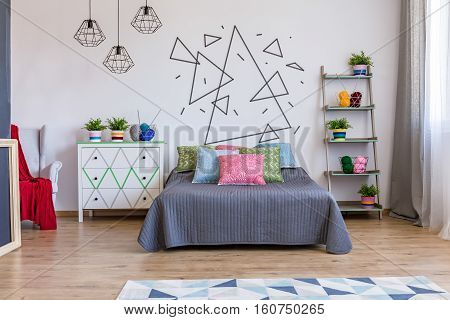 Bright Bedroom With Commode And Bed
