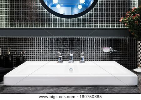 Interior of bathroom with sink basin and faucet. Modern design of bathroom.