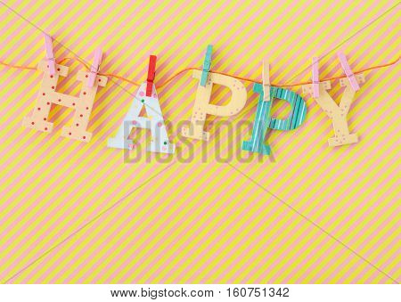 Colorful HAPPY banner on background with stripes