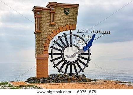 KULTUK IRKUTSK REGION RUSSIA - July 31.2016: Monument marks end of Circum-Baikal Railway. Located on shore near water of Lake Baikal
