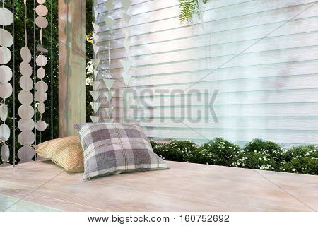 Beautiful wooden front porch swing with comfortable pillows in cozy home
