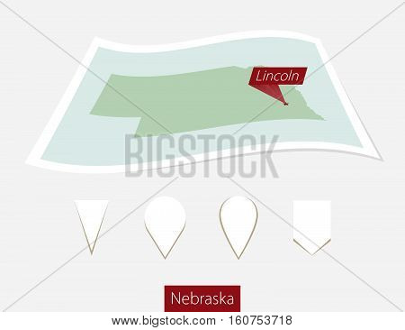 Curved Paper Map Of Nebraska State With Capital Lincoln On Gray Background. Four Different Map Pin S