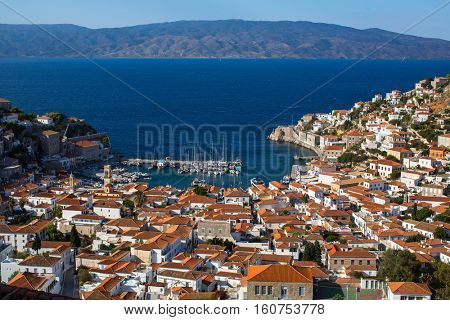Top view on houses and yachts marina at Hydra island, Greece, Aegean sea.