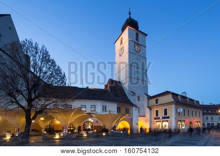 SIBIU, ROMANIA - NOVEMBER 26th 2016: Downtown and main square at dusk with lights on, on the 26th of November in Sibiu, Romania