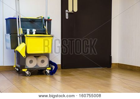 Professional cleaning equipment in corridor. Miscellaneous tools and items.