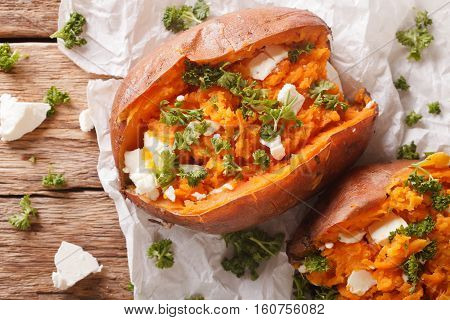Healthy Food: Baked Sweet Potato Stuffed With Cheese And Parsley Close-up. Horizontal Top View