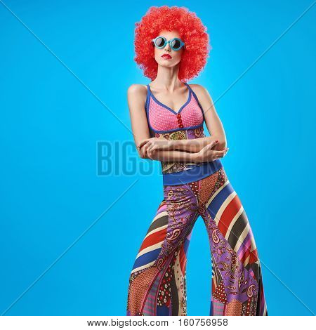 Fashion portrait Hipster Model woman, Stylish hairstyle. Fashion Makeup. Cheeky Sexy Model girl, Stylish summer fashion Outfit. Trendy Glamour Sunglasses. Playful Afro hairstyle. Party Disco Creative