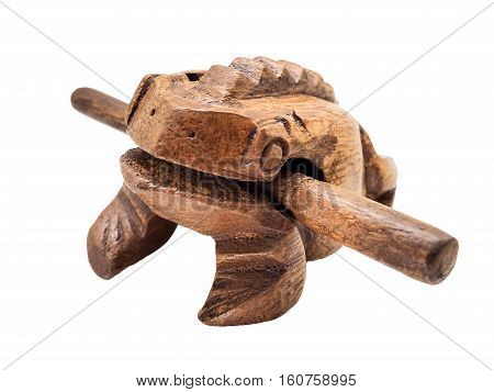 Selective focus / Wooden Frog toy that makes croaking sound by sliding the striker up and down the ridges of the body, White background