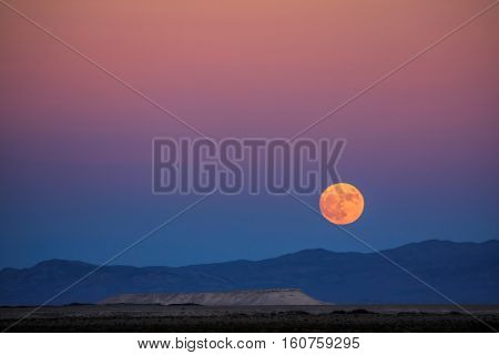 Orange moon over the mountains of Nevada