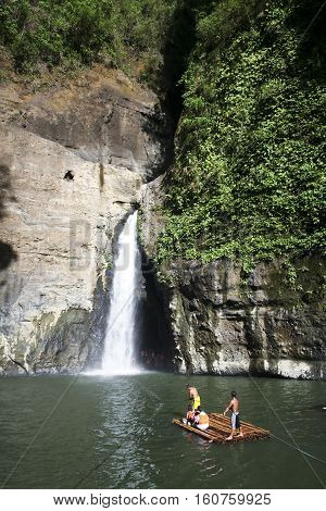 Pagsaŋjan Falls Philippines - Apr 26 2007: Tourists on rafts pulled through Pagsaŋjan Falls in Laguna Philippines. Pagsaŋjan Falls are the most famous waterfalls in the Philippines an attraction since the Spanish Colonial Era.