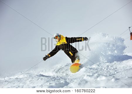 Snowboarder riding very fast extreme downhill on ski slope. Sheregesh backcountry
