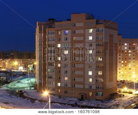 multi-storey building in the evening in the winter against the blue sky
