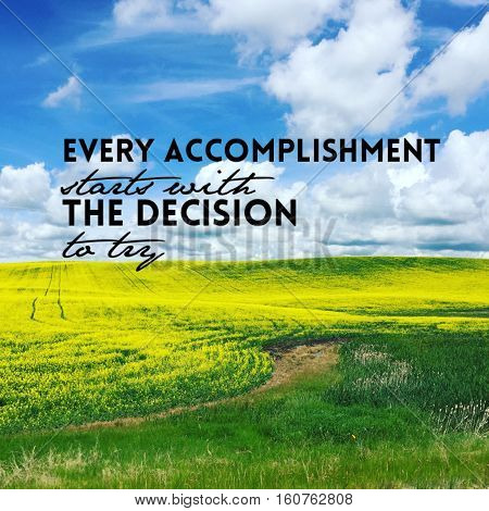 Conceptual inspirational landscape. Beautiful bright yellow canola field landscape with inspirational quote. Bright blue sky white clouds background.Dark lush green grass.Tracks and trail through field.Instagram effects