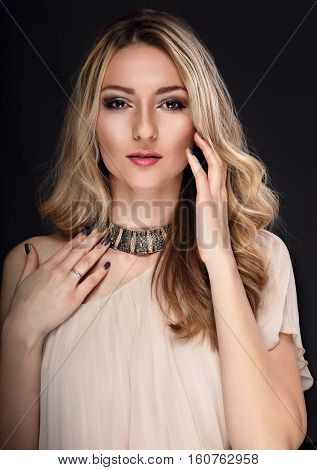 Beautiful Makeup Fashion Graceful Woman With Modern Necklace And Manicured Nails Looking On Grey Bac