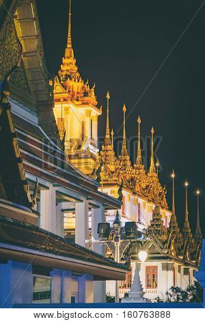 Wat Ratchanatdaram Temple at night Bangkok Thailand. Temple was submitted to UNESCO for consideration as a future World Heritage Site.