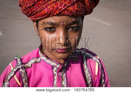 Agra, India - Nov 14, 2016: Portrait Of Happy Tribal Dancer Girl Performing For Donate In Oil Statio