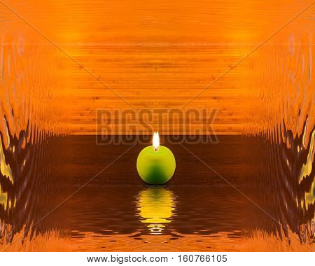 Abstract concept with green candle and reflection
