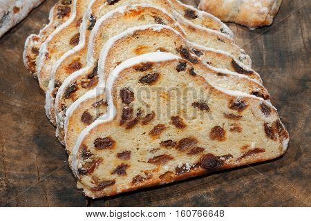 Christmas stollen with Christmas decoration on a wooden plate