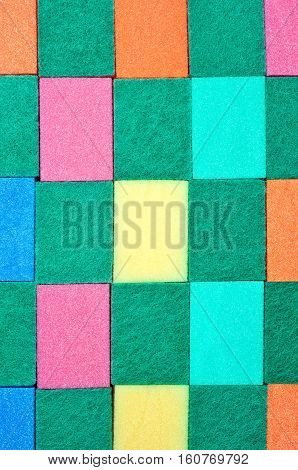 Conceptual background made of colorful scouring sponges