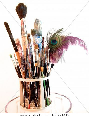 many art brushes in a bin for painting
