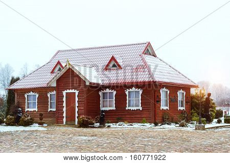 Lithuanian countryside snowy winter. Baltic rustic architecture with wooden houses landscaped Park. Roadside tourist attraction. Griezpelkiai Republic of Lithuania European Union