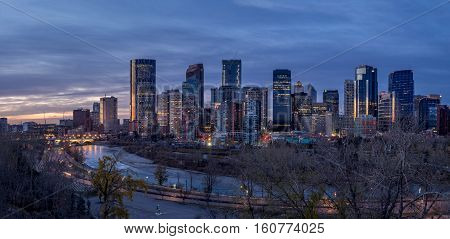 CALGARY, CANADA - OCT 22: Sweeping skyline view at sunrise on October 22, 2016 in Calgary, Alberta. Calgary is home to many oil companies.