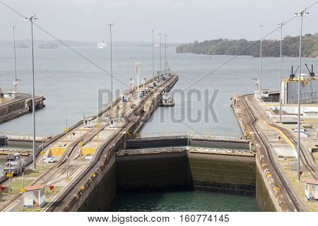 The view of canal locks with an artificial lake behind (Panama).