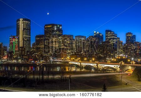 CALGARY, CANADA - DEC 3: Sweeping skyline view at sunset on December 3, 2016 in Calgary, Alberta. Calgary is home to many oil companies.