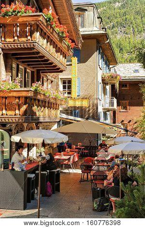 Tourists At Terrace Restaurant At Center Zermatt