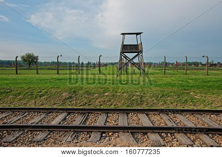Guard Tower And Rail Track In Auschwitz Birkenau Concentration Camp